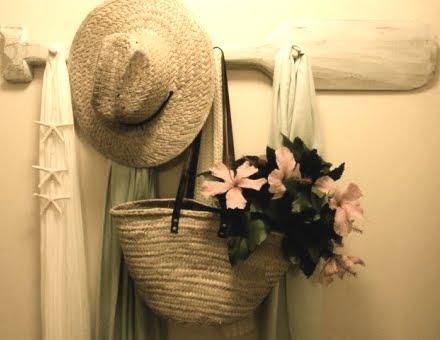 straw hat on oar rack